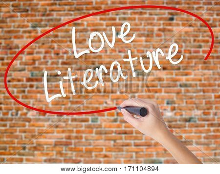 Woman Hand Writing Love Literature With Black Marker On Visual Screen.