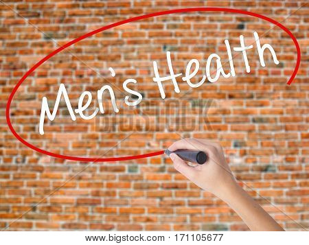 Woman Hand Writing Men's Health With Black Marker On Visual Screen