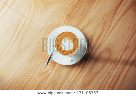 Art Cappuccino Coffee on Wooden table background.
