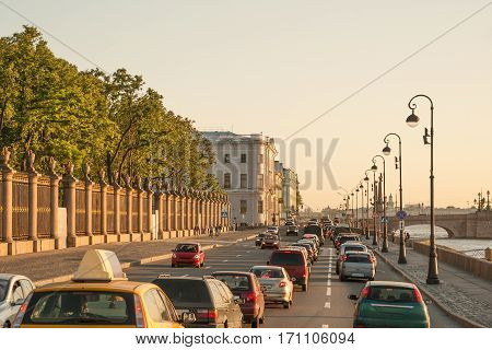 Evening traffic on Palace embankment and Trinity bridge in downtown Saint Petersburg