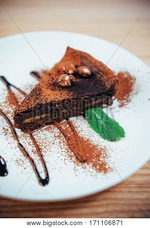 Delicious chocolate cake with hazelnuts and chocolate