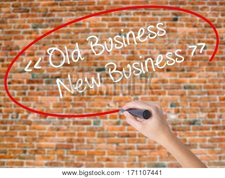 Woman Hand Writing Old Business - New Business With Black Marker On Visual Screen