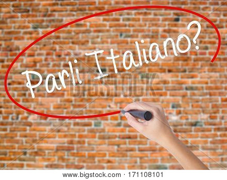 Woman Hand Writing Parli Italiano? With Black Marker On Visual Screen.