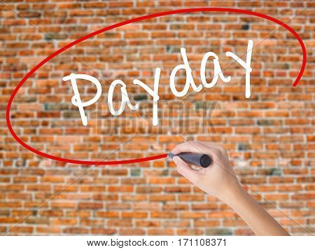 Woman Hand Writing Payday With Black Marker On Visual Screen