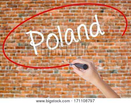 Woman Hand Writing Poland  With Black Marker On Visual Screen