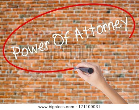 Woman Hand Writing Power Of Attorney With Black Marker On Visual Screen