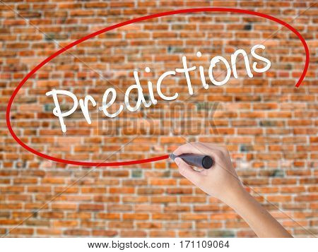 Woman Hand Writing Predictions  With Black Marker On Visual Screen
