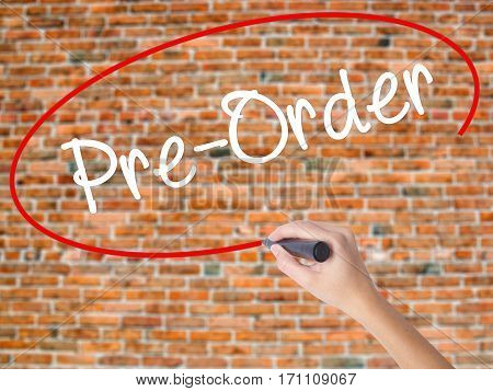 Woman Hand Writing Pre-order  With Black Marker On Visual Screen