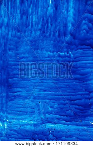 blue paint on glass backgrounds abstract texture