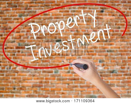 Woman Hand Writing Property Investment With Black Marker On Visual Screen