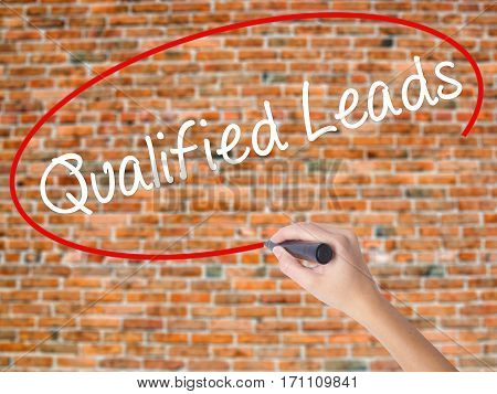 Woman Hand Writing Qualified Leads With Black Marker On Visual Screen