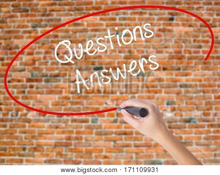 Woman Hand Writing Questions Answers With Black Marker On Visual Screen