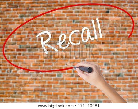 Woman Hand Writing Recall  With Black Marker On Visual Screen