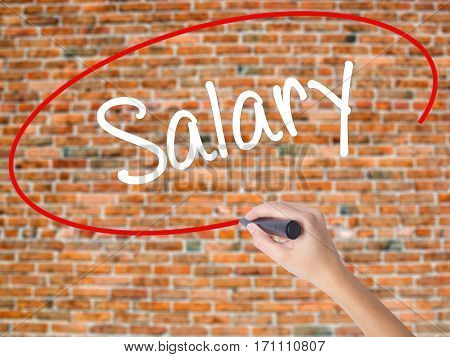 Woman Hand Writing Salary  With Black Marker On Visual Screen