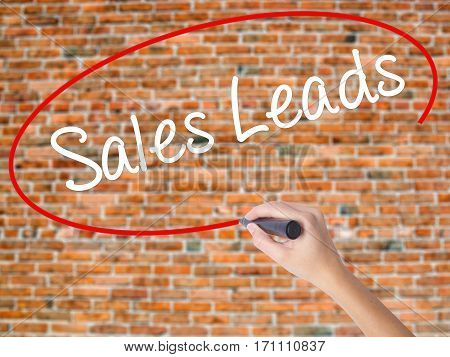 Woman Hand Writing Sales Leads With Black Marker On Visual Screen