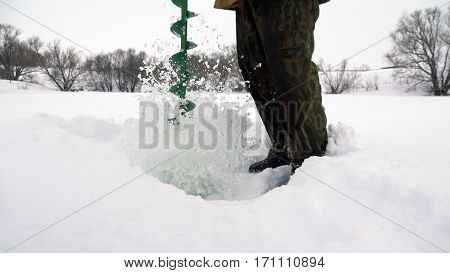 Fisherman catches a fish on ice fishing