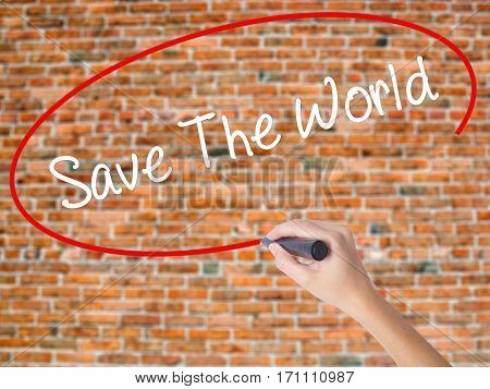 Woman Hand Writing Save The World With Black Marker On Visual Screen.