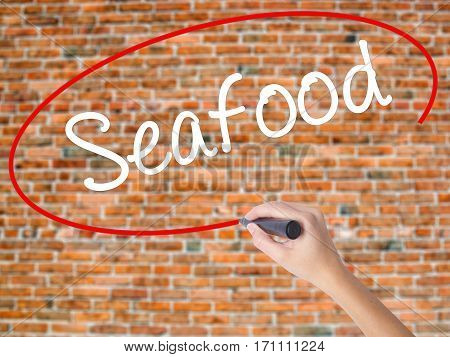Woman Hand Writing Seafood With Black Marker On Visual Screen