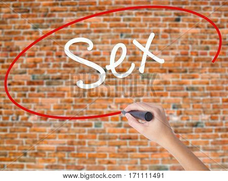 Woman Hand Writing Sex With Black Marker On Visual Screen
