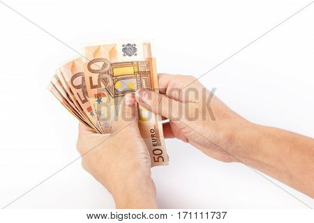 Close up of female hand holding 50 euro banknotes isolated on white background