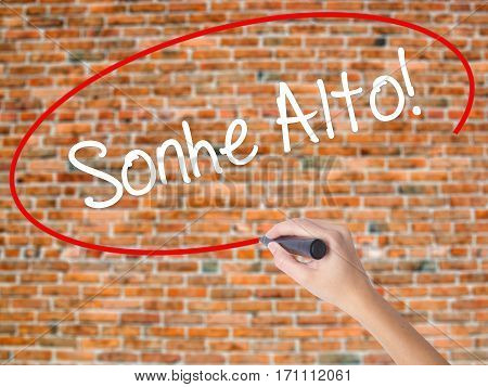Woman Hand Writing Sonhe Alto! (dream Big In Portuguese) With Black Marker On Visual Screen