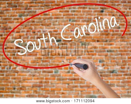Woman Hand Writing South Carolina With Black Marker On Visual Screen.