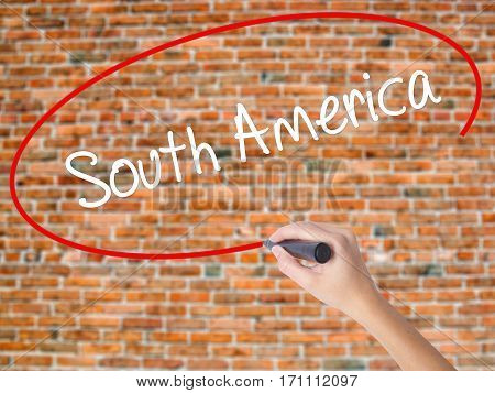 Woman Hand Writing South America With Black Marker On Visual Screen