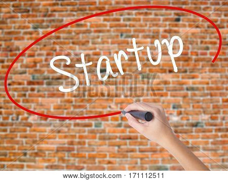 Woman Hand Writing Startup  With Black Marker On Visual Screen