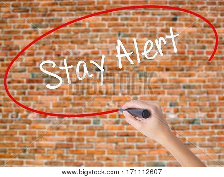 Woman Hand Writing Stay Alert With Black Marker On Visual Screen