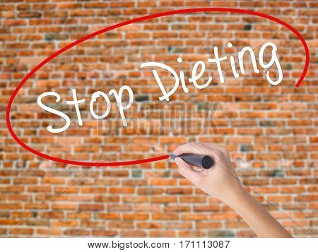 Woman Hand Writing Stop Dieting With Black Marker On Visual Screen.