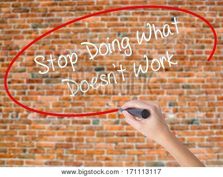Woman Hand Writing Stop Doing What Doesn't Work With Black Marker On Visual Screen