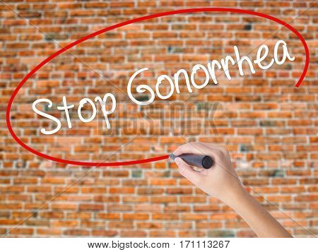 Woman Hand Writing Stop Gonorrhea With Black Marker On Visual Screen.