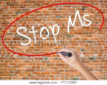 Woman Hand Writing Stop Ms With Black Marker On Visual Screen
