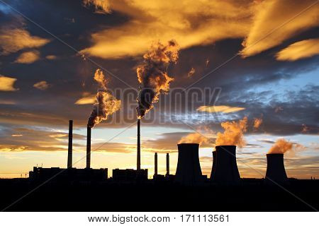 colour dramatic sunset and smoking power plant