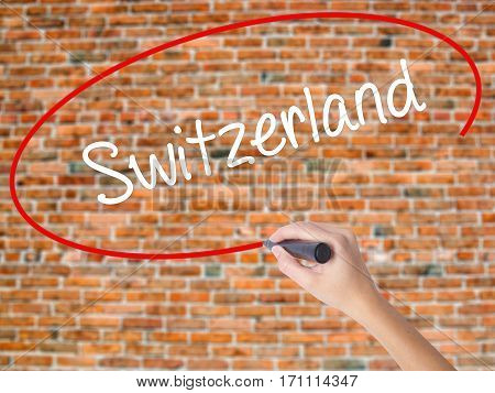 Woman Hand Writing Switzerland  With Black Marker On Visual Screen