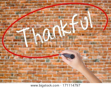 Woman Hand Writing Thankful  With Black Marker On Visual Screen