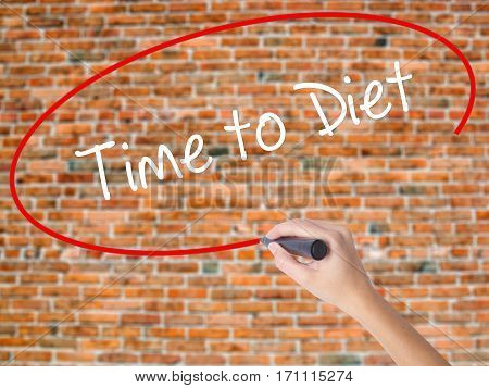 Woman Hand Writing Time To Diet With Black Marker On Visual Screen