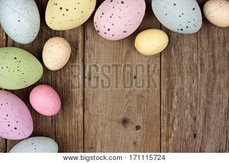 Pastel Speckled Easter Egg Corner Border Against A Rustic Wood Background