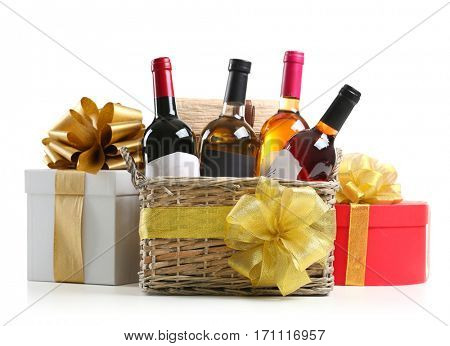 St. Valentines Day concept. Wine bottles in basket and gift boxes isolated on white