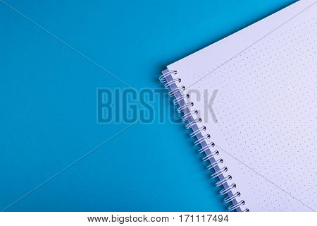 Notebook, blue background texture, empty space for copy