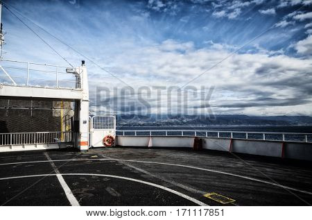 View of the sea of Strait of Messina from the bow of a ferry boat