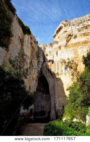 The entrance to the cavern known as the Orecchio di Dionisio (Ear of Dionysus) in the Archaeological Park in Syracuse, Sicily, Italy
