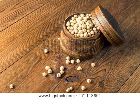 Portion of Chick Peas in wooden bowl.