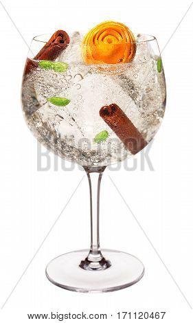 Gin Tonic with Cinnamon, Cardamom and Orange Rose Garnish