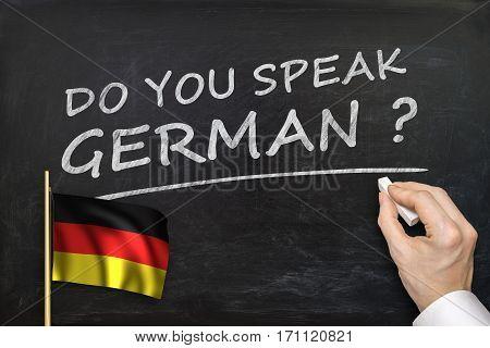 Do You Speak German? Text Written On Blackboard.