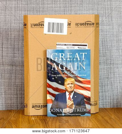 PARIS FRANCE - FEB 9 2017: Great Again - how to fix our crippled America biography book by Donald J Trump in front of Amazon delivery box. Crippled America: How to Make America Great Again is a book by Donald Trump published by Simon & Schuster in 2015
