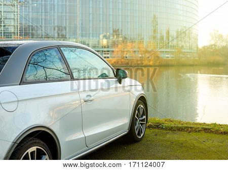 STRASBOURG FRANCE - FEB 2 2017: Audi A1 car parked in front of the European Parliament building in Strasbourg Alsace France