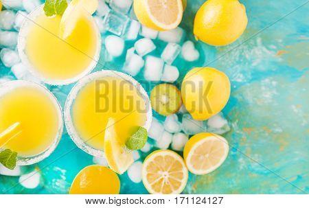 Orange juice. Orange cocktails on a turquoise background. Kiwi. Cocktails. Detox Juice. Orange smoothie. summer drink.