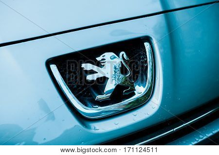 STRASBOURG FRANCE - FEB 12 2017: Lion logotype of Peugeot car manufacturer in blue technological colorcast. Peugeot is one of the bigest car manufacturer in the world
