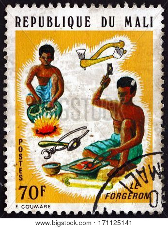 MALI - CIRCA 1974: a stamp printed in Mali shows Smiths Artisans of Mali circa 1974